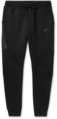 630cfb13744f Nike Slim-Fit Tapered Cotton-Blend Tech Fleece Sweatpants