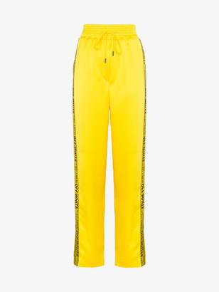 Off-White industrial logo striped track pants