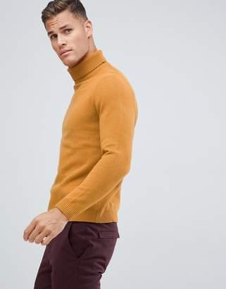 Asos Design DESIGN lambswool roll neck sweater in mustard