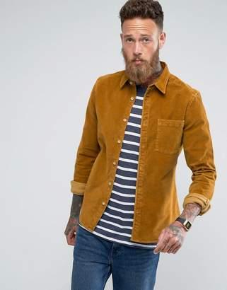 Asos DESIGN slim fit cord shirt in mustard