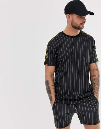 8eca6972d2f90 Asos Design DESIGN co -ord relaxed t-shirt in stripe with baroque sleeve  panels