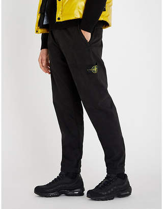 Stone Island Logo-patch regular-fit straight stretch-cotton trousers