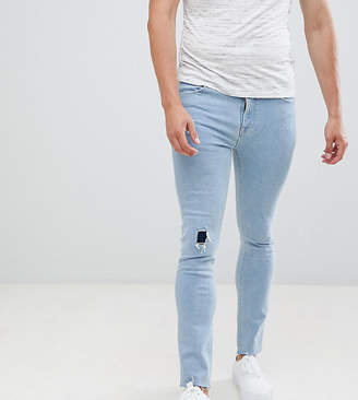 d1b61ed69dc1 Asos Design DESIGN super skinny jeans in bleach wash with rip and repair