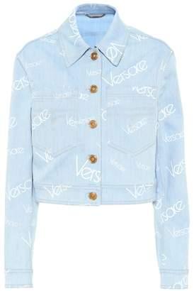 1c7b2e59c863 Versace Logomania cropped denim jacket