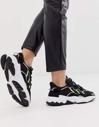 adidas Ozweego trainers in black and green