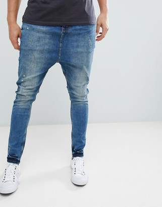 Asos DESIGN Drop Crotch Jeans In Dark Wash Blue With Abrasions