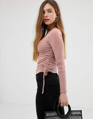 Bershka ruched side jersey top in pink