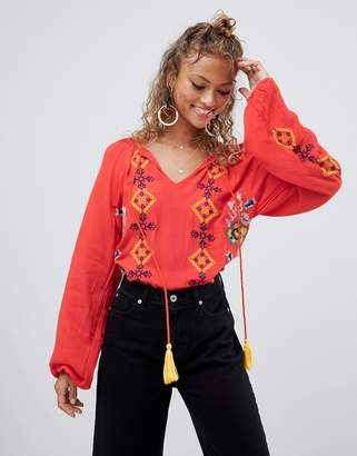 Glamorous embroidered blouse with tassel detail