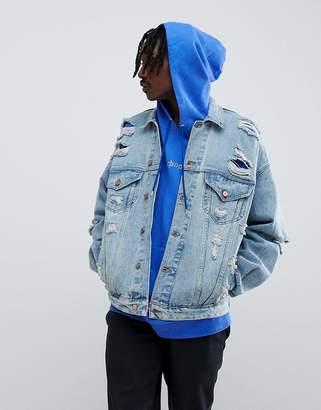 Asos Design DESIGN oversized denim jacket with rips