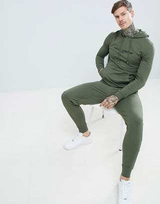 Asos DESIGN tracksuit muscle hoodie/super skinny joggers with text print