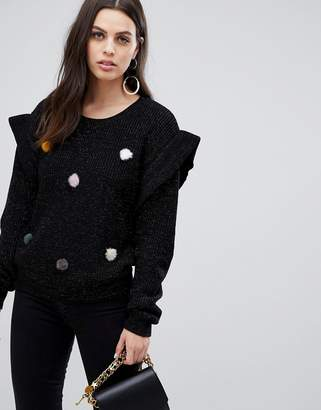 Liquorish tinsel sweater with faux fur pom poms
