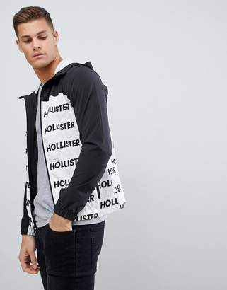 Hollister unlined lightweight hooded jacket with black & white print logo