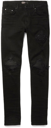 AMIRI MX1 Skinny-Fit Leather-Trimmed Distressed Stretch-Denim Jeans $1,040 thestylecure.com