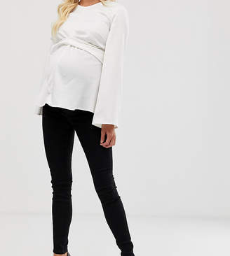 Asos DESIGN Maternity Tall Ridley skinny jeans in clean black with over the bump waistband