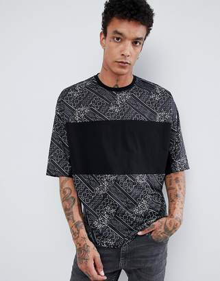 Asos Design DESIGN oversized t-shirt with half sleeve and patterned panels