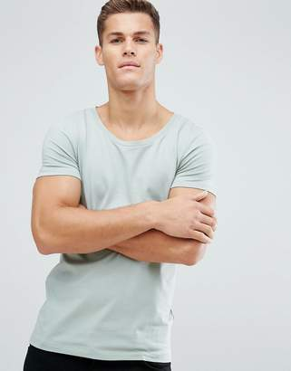 Asos DESIGN muscle fit t-shirt with scoop neck in green