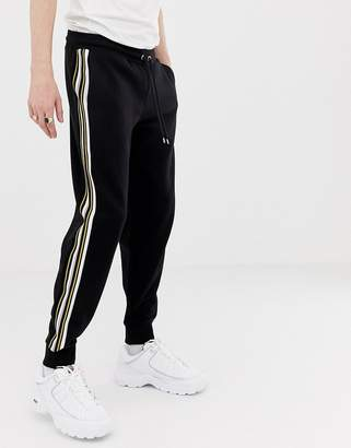 Asos Design DESIGN two-piece skinny sweatpants with side stripes