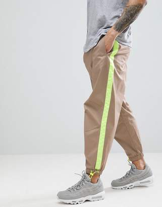Asos DESIGN Tapered Woven Joggers In Stone With Neon Side Tape