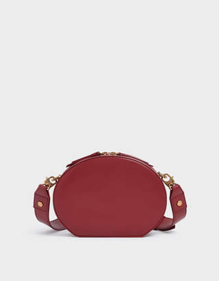 Charles & Keith Wrinkled Patent Oval Crossbody Bag