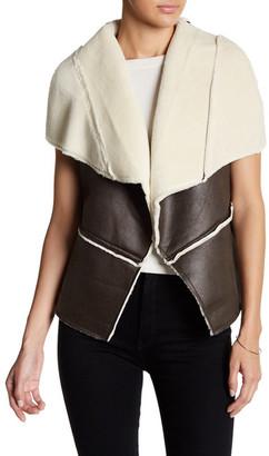 En Creme Faux Shearling Vest $72 thestylecure.com