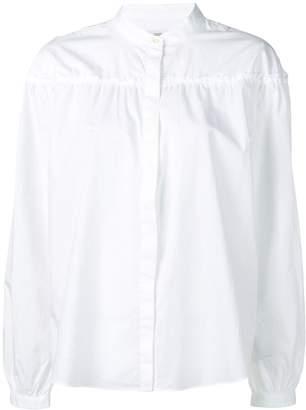 Closed collarless shirt