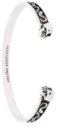 Alexander McQueen engraved twin skull bracelet