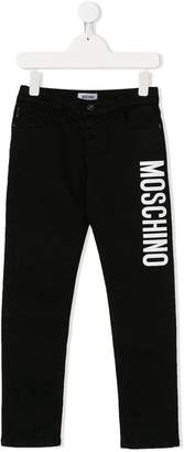 Moschino Kids logo print trousers