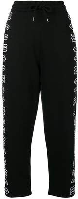 McQ cropped repeat logo track pants