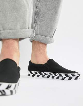 Asos Design DESIGN slip on plimsolls in black canvas with diagonal checkerboard sole