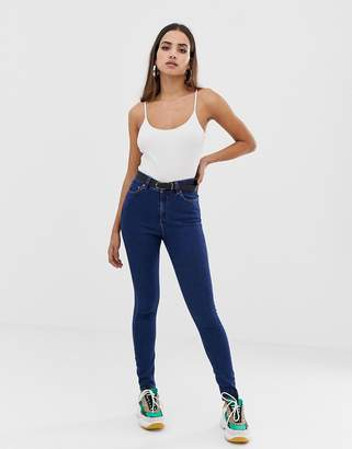 Asos DESIGN Ridley high waist skinny jeans in deep blue wash
