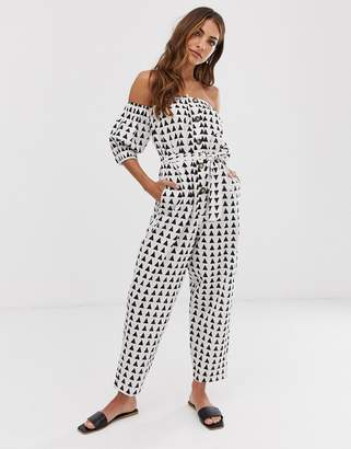 Asos Design DESIGN off shoulder button front jumpsuit with tie waist in triangle print