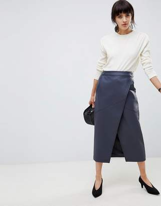 Asos Design DESIGN leather look wrap midi skirt with buckle belt