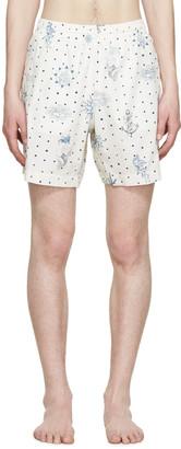 Alexander McQueen Cream Tattoo Swim Shorts $365 thestylecure.com