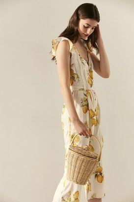 Urban Outfitters Roseanne Straw Bucket Bag $49 thestylecure.com
