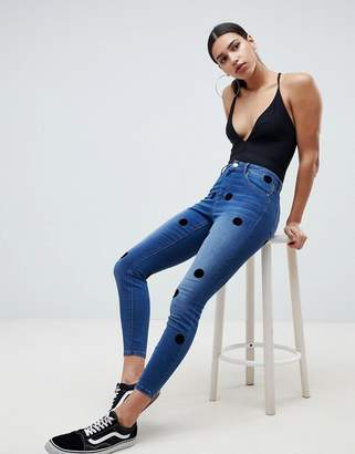 7f8a423a195 at ASOS · Asos Design DESIGN Ridley High Waist Skinny Jeans In Dark Stone  Wash With Large Flock Spots