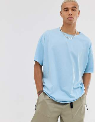 Asos Design DESIGN oversized t-shirt with raw neck in blue
