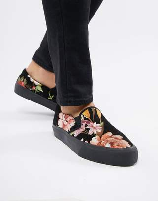 Asos DESIGN slip on plimsolls in black with floral print