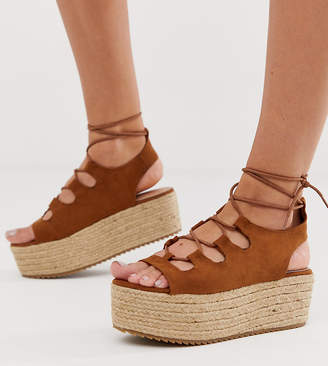 e389b33bbba3 New Look suedette lace up flatform sandal in tan