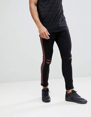 Jaded London Super Skinny Distressed Jeans With Side Stripe In Black