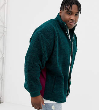 Asos DESIGN plus oversized borg track jacket in green with rib panels
