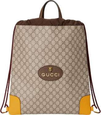 Gucci GG Supreme Backpack, Drawstring Monogram GG Oval Leather tag with Feline Head Beige/Yellow