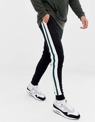 Asos DESIGN super skinny joggers with side stripes in black