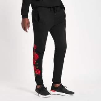 Criminal Damage black rose embroidered jogger