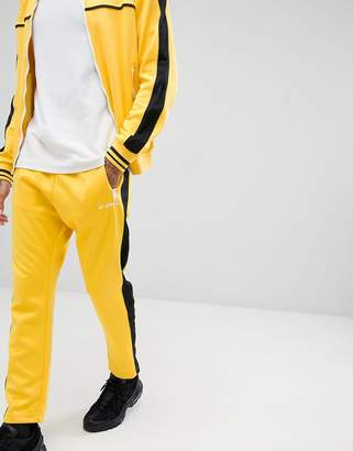 Diesel two-piece P-Ska side stripe sweatpants in yellow