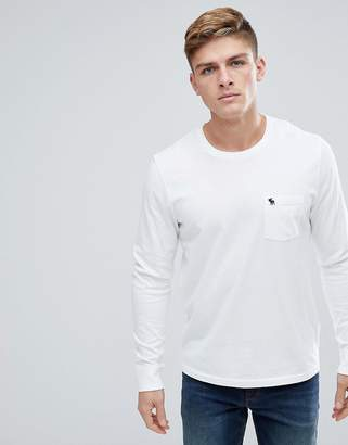 Abercrombie & Fitch Crew Neck Pocket Long Sleeve Top Tonal Logo in Bright White