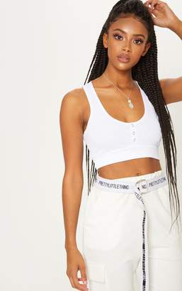 PrettyLittleThing White Bandage Popper Racerback Crop Top