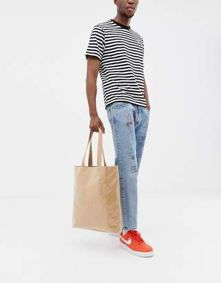 Asos DESIGN tote bag in brown paper with plastic cover