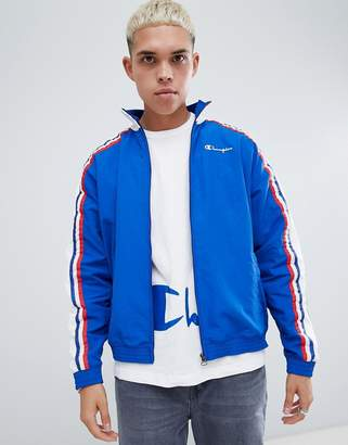 Champion track jacket with logo sleeve print in blue