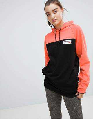New Balance Colourblock Pullover Hoodie In Coral