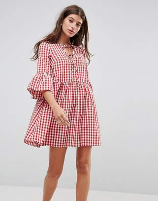 ASOS Lace Up Gingham Smock Dress with Fluted Sleeve $51 thestylecure.com